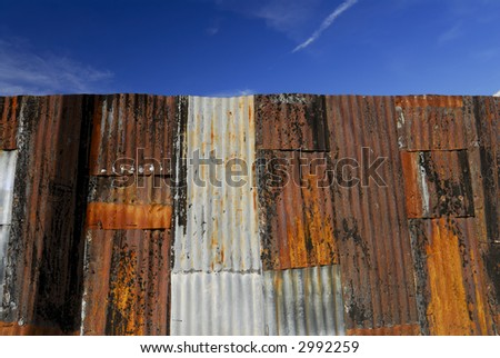 Rusting Fence in the Tucson Barrio - stock photo