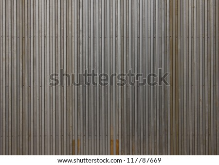 Rusting metal fencing or siding - stock photo