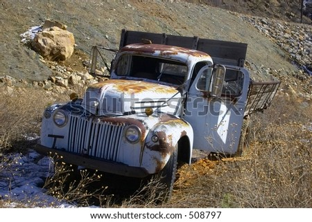 Rusty abandoned truck - stock photo