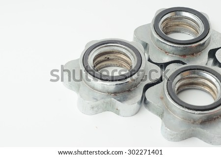 RUSTY AND DUSTY DUMBELL LOCK NUTS ISOLATED IN WHITE BACKGROUND - stock photo