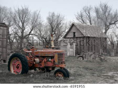Rusty Antique Red Tractor on Farm - see more in portfolio - stock photo