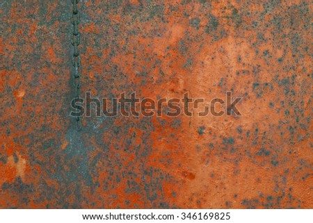 Rusty background , rusted metal texture and chain - red wall  - stock photo