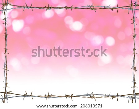 Rusty barbed wire frame on Pink Bokeh background