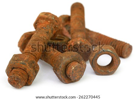 Rusty bolt and nut over white background  - stock photo