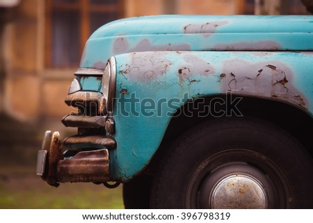 Rusty bumper of old blue car - stock photo