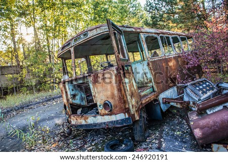 rusty bus in Jupiter Factory in Pripyat ghost town, Chernobyl Nuclear Power Plant Zone of Alienation, Ukraine - stock photo