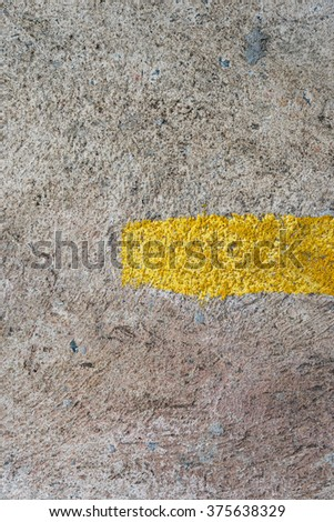 Rusty cement floor with yellow line