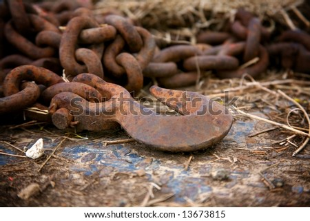 rusty chain and hook - stock photo