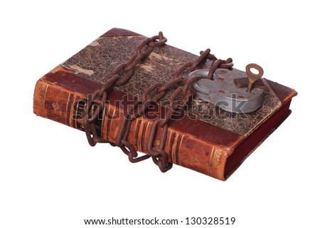 rusty chain and padlock on old book - stock photo