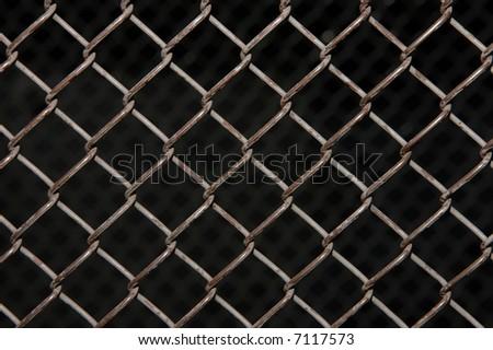 Rusty chain link on black - stock photo
