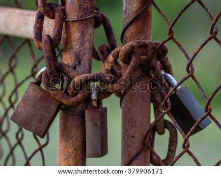 Rusty Chain & Padlocks on Gate - stock photo