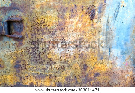 Rusty colored metal texture with cracked paint, grunge background