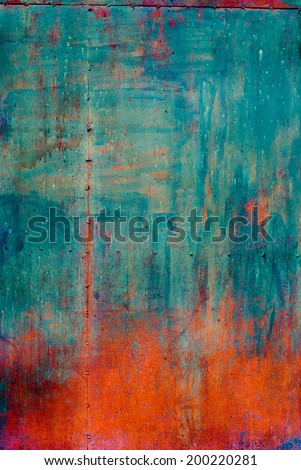 Rusty Colored Metal with cracked paint, grunge background, Blue and Orange - stock photo
