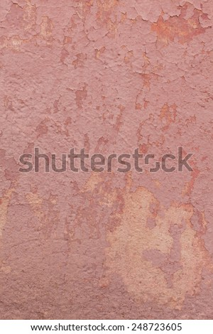 Rusty Colored stone surface with cracked paint, grunge background. Color trend. Vintage