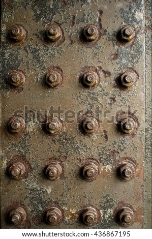 rusty construction with rivets and nuts - stock photo