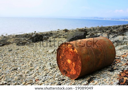 Rusty container on the beach - stock photo