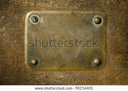Rusty copper name plate on wood background. - stock photo