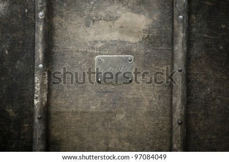 Rusty copper name plate on wood background framed. - stock photo