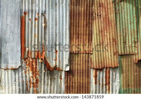 Rusty corrugated metal wall texture background - stock photo