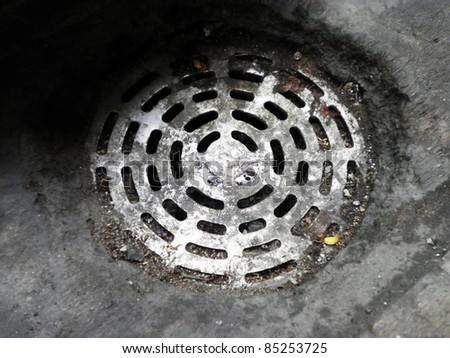Rusty dirty drain water on the floor - stock photo
