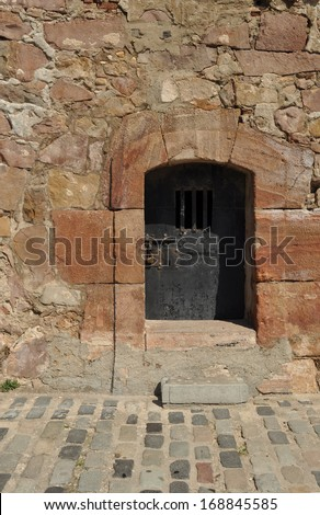 Rusty door at the Montju�¯c castle in Barcelona, Spain. The castle was used  as a military prison and instrument of oppression. - stock photo