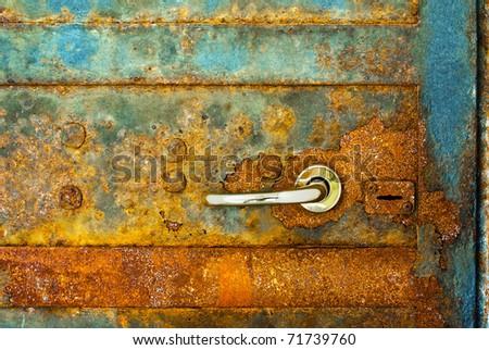 rusty door with shiny heck - stock photo