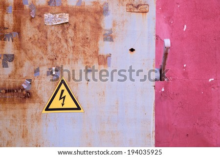 rusty electrical box on  pink background wall - stock photo
