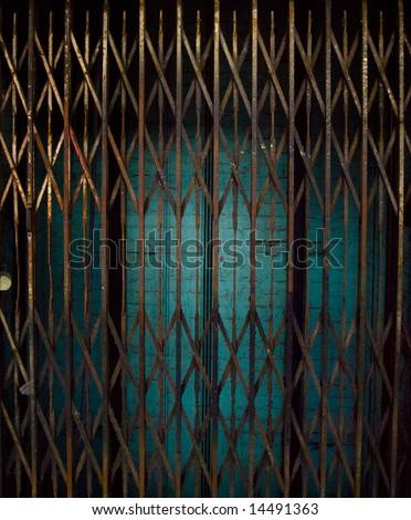 Rusty Elevator Gates and Dark Lift Shaft - stock photo