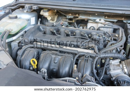 rusty engine of modern car - stock photo