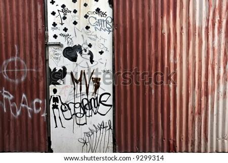 Rusty fence and grafitti - stock photo