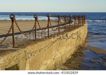 Rusty Fence at the Salt Water Baths, Newcastle, NSW, Australia - stock photo