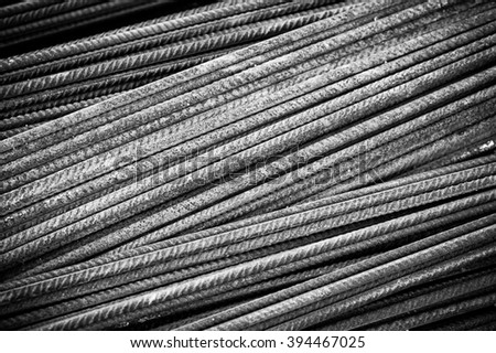 Rusty ferro concrete construction steel building armature as background, black and white image - stock photo