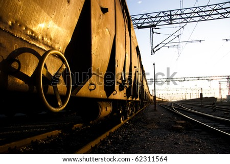 Rusty Freight trains on sunrise with golden reflection - stock photo