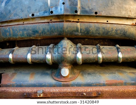Rusty front of a vintage car - stock photo