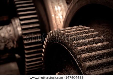 Rusty industrial machine parts closeup photo - stock photo