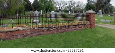 Rusty iron cemetery fence - stock photo