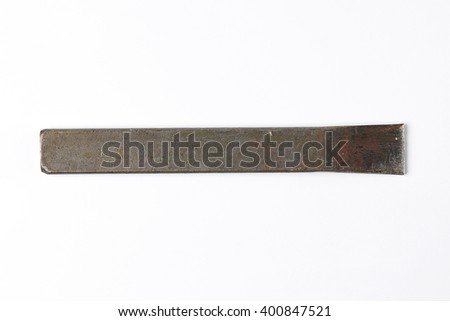 Rusty Iron Chisel isolated on White Background. Top View of Vintage Construction Tools with Copy Space for Tex or Image. Real Shadow - stock photo