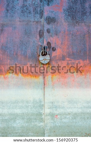 rusty iron door with the lock - stock photo