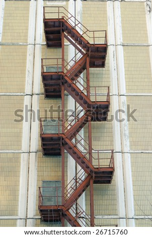 Rusty iron fire escape stairway - stock photo