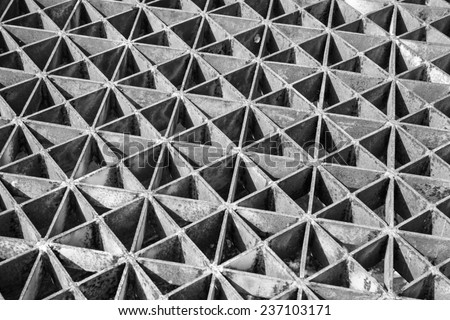 Rusty iron grille in black-white tone - stock photo