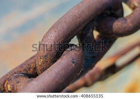 Rusty links of a giant chain - stock photo