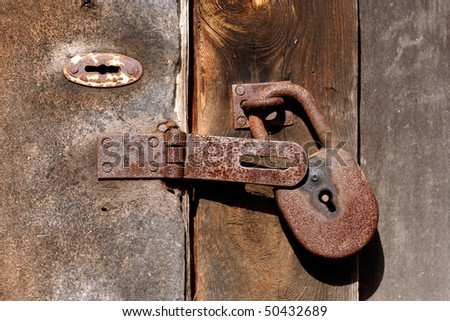 rusty lock and keyhole - stock photo