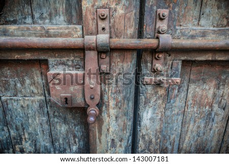 Rusty lock of old gates of Buonconsiglio castle in Trento, Trentino, Italy- details of the internal gate. - stock photo