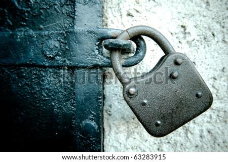 Rusty Lock on an iron Door - stock photo