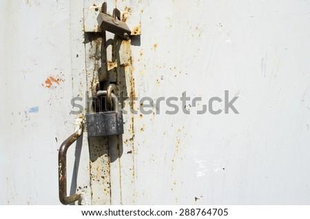 rusty lock on an old door - stock photo