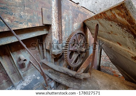 Rusty machine in an abandoned factory - stock photo