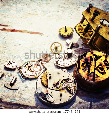 rusty mechanism from the old clock on the texture background/vintage time concept background - stock photo
