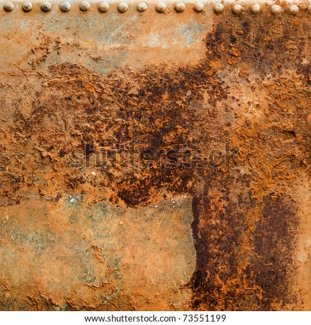 Rusty Metal Background with rusted bolts or rivets - stock photo