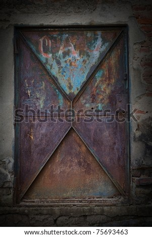 rusty metal door - stock photo