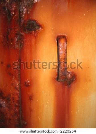 Rusty metal door and handle - stock photo
